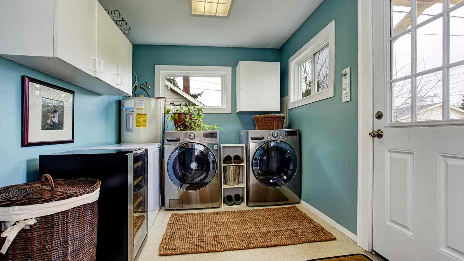 high efficiency washer and dryer in a pretty laundry room