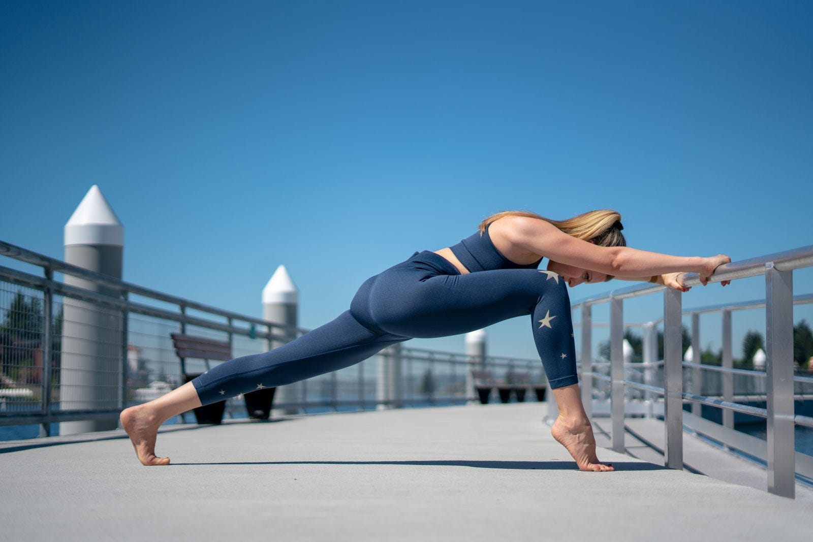 A woman in the Runner's Lunge Yoga pose.