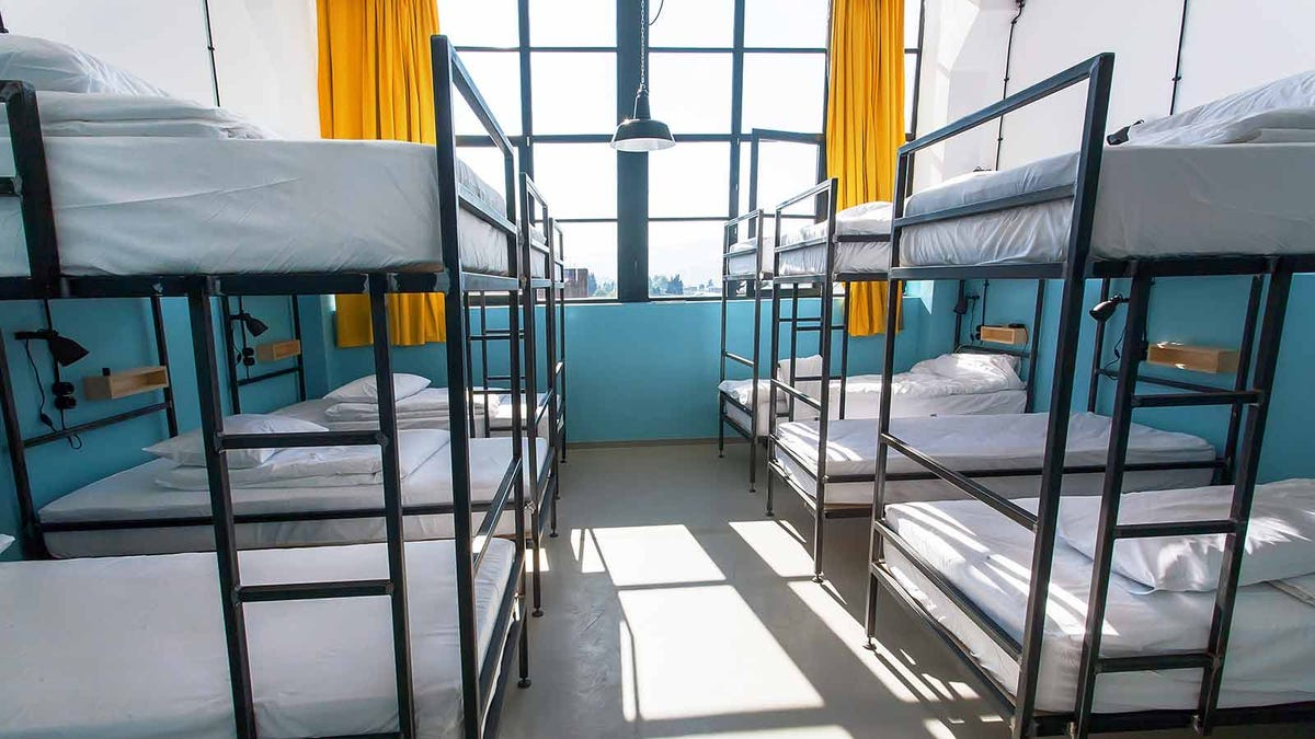 Bunk beds along both sides of a room.