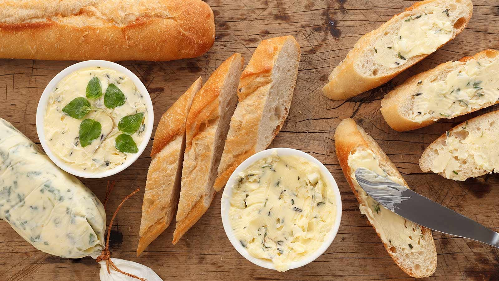 fresh bread with delicious compound butters in dishes
