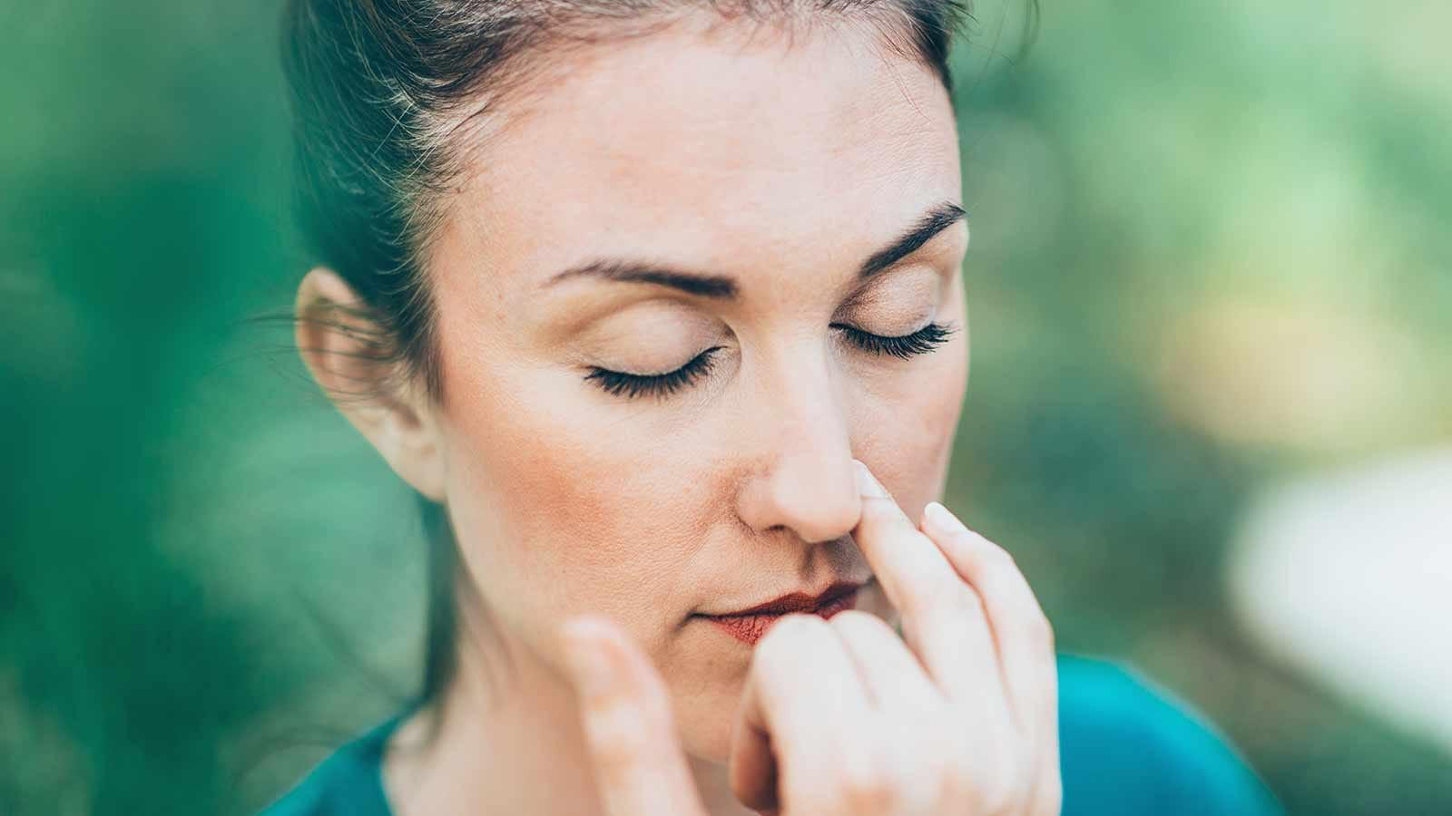 woman practicing yogic breathing