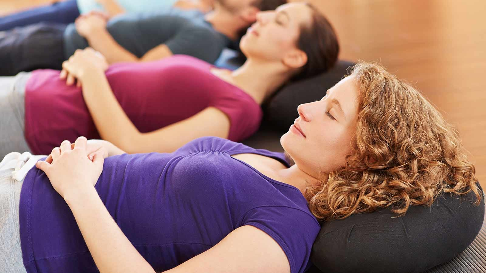 people practicing deep breathing exercises