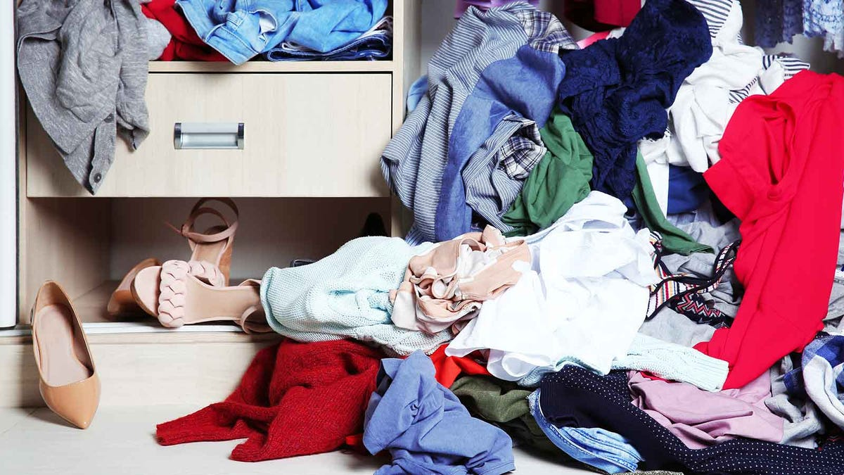 messy closet overflowing with clothing