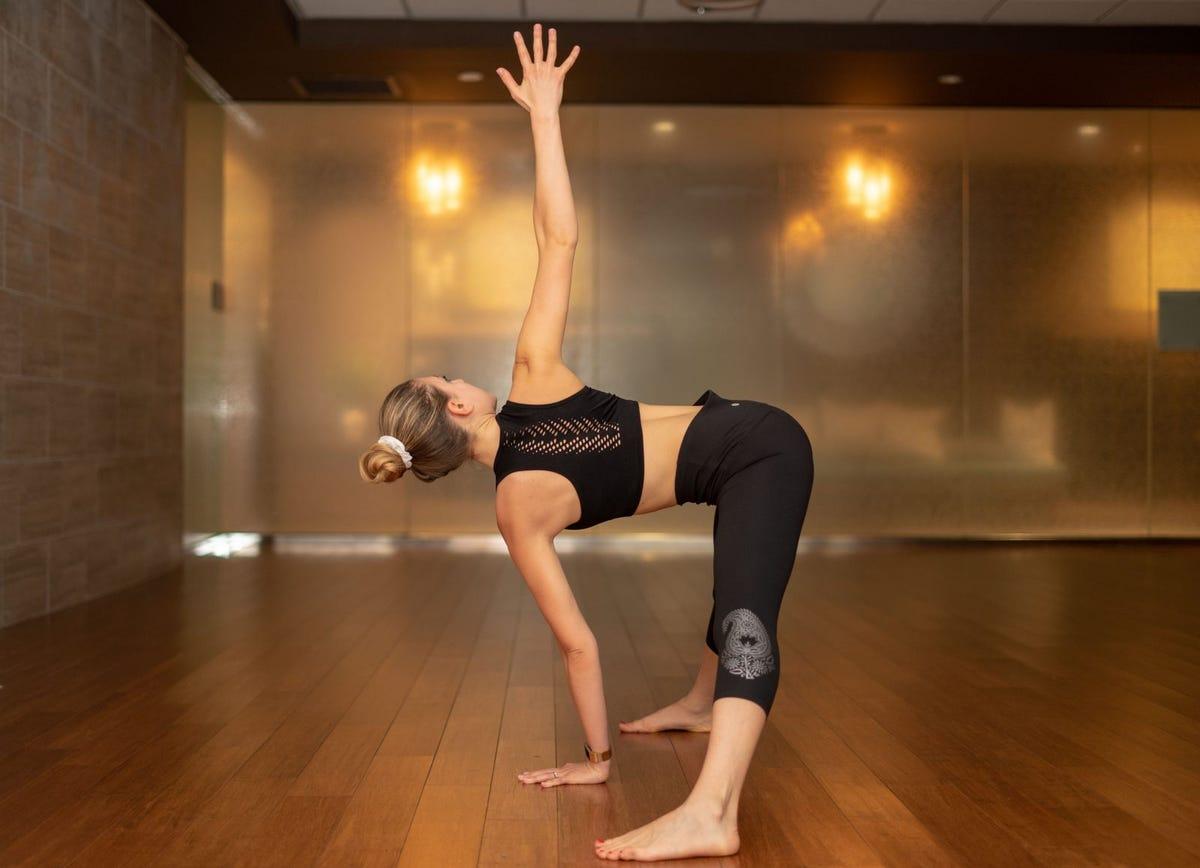 Woman doing forward fold twist