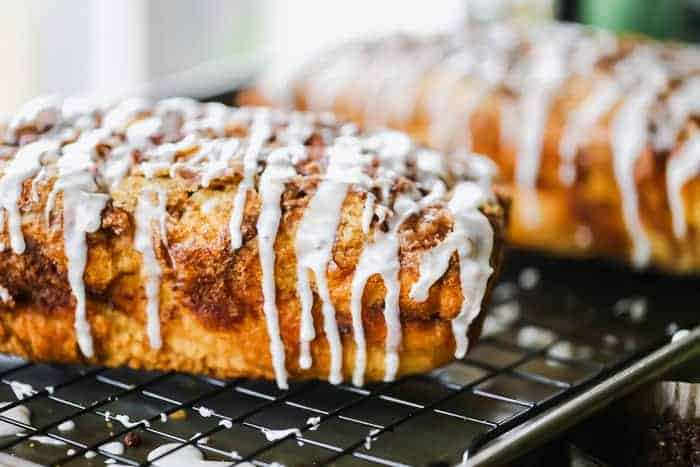 Apple fritter bread on a cooling rack