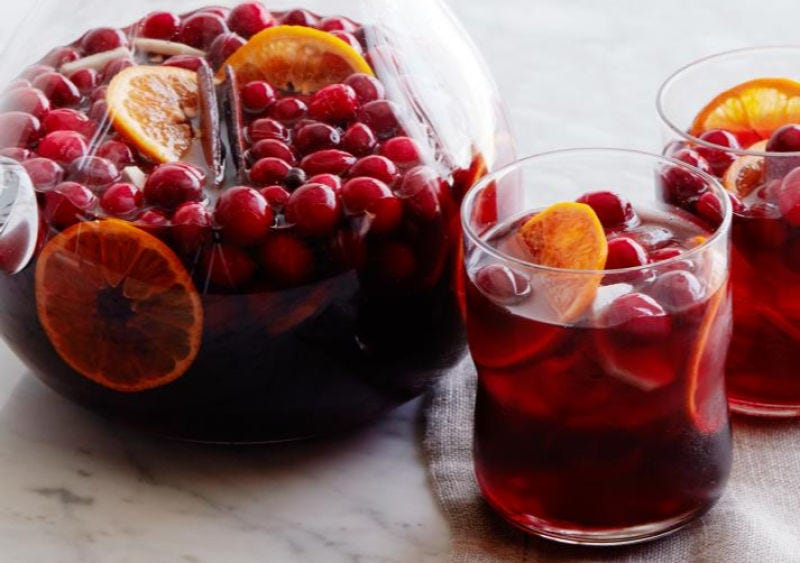 A pitcher and two glasses full of mulled wine sangria