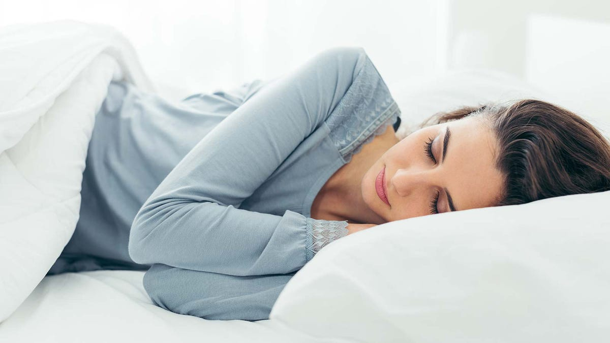 A woman asleep in bed.