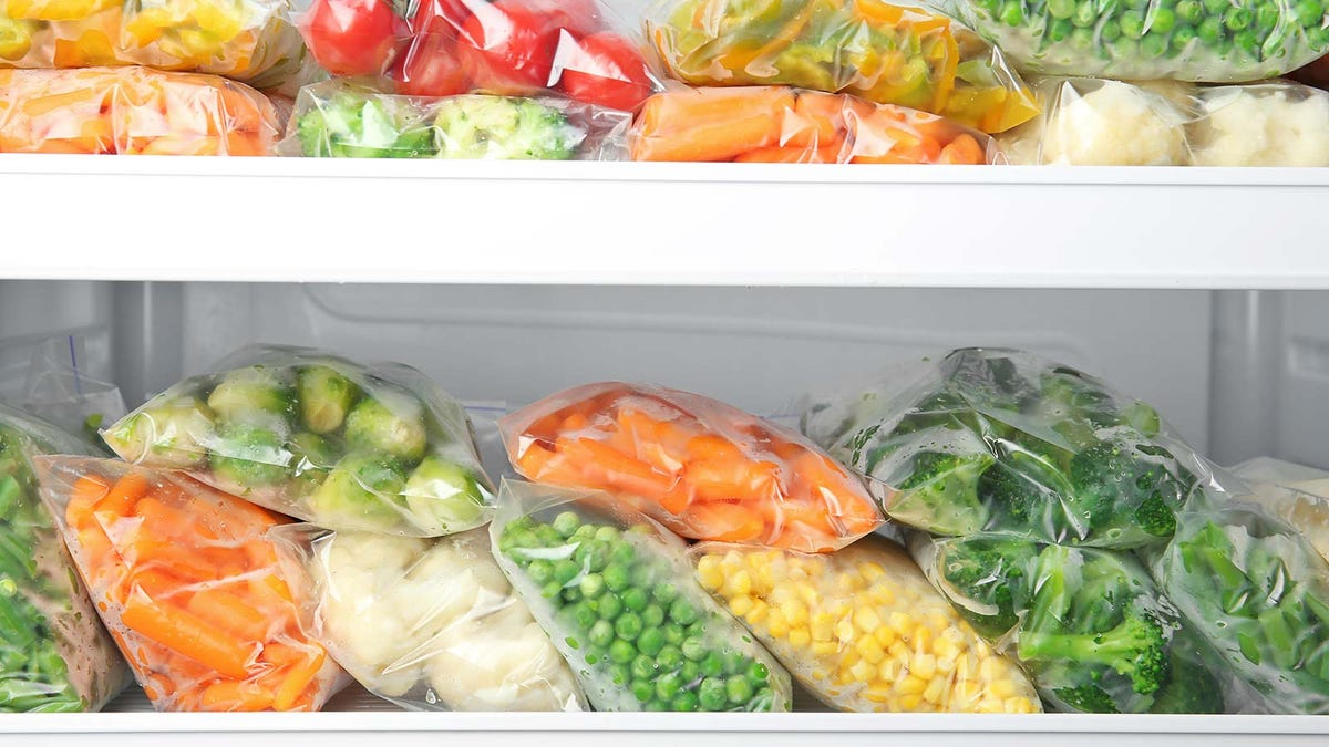 Vegetables bagged and frozen in a deep freezer.