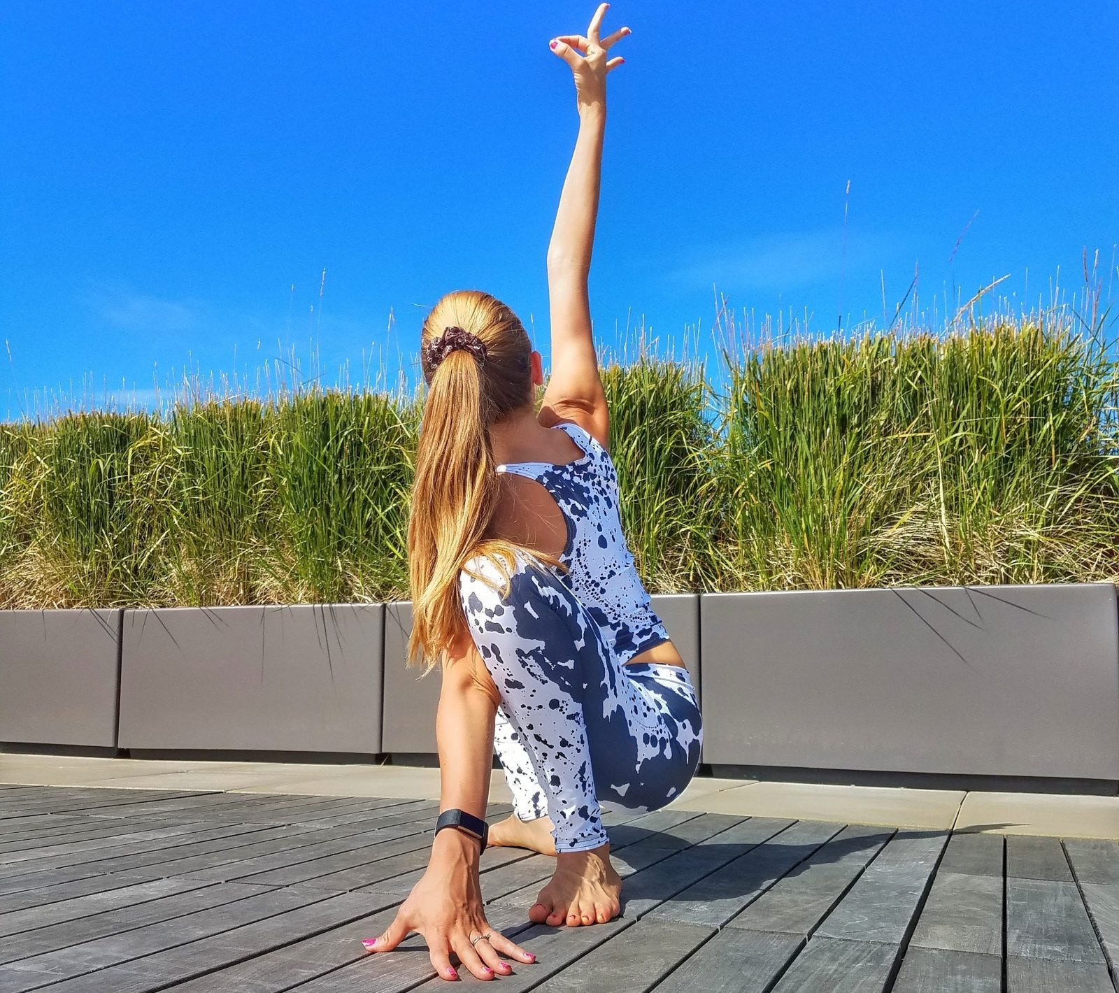 Woman doing a yogi squat on a terrace