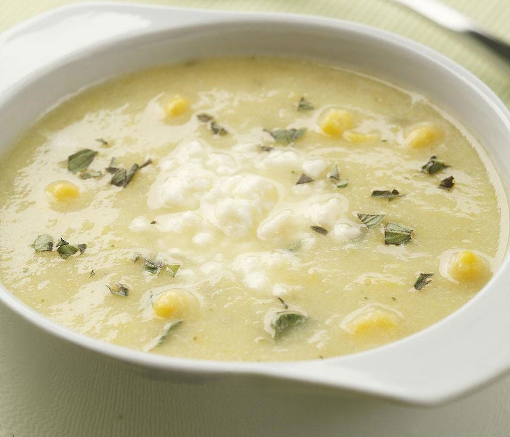 A bowl of summer squash and corn soup