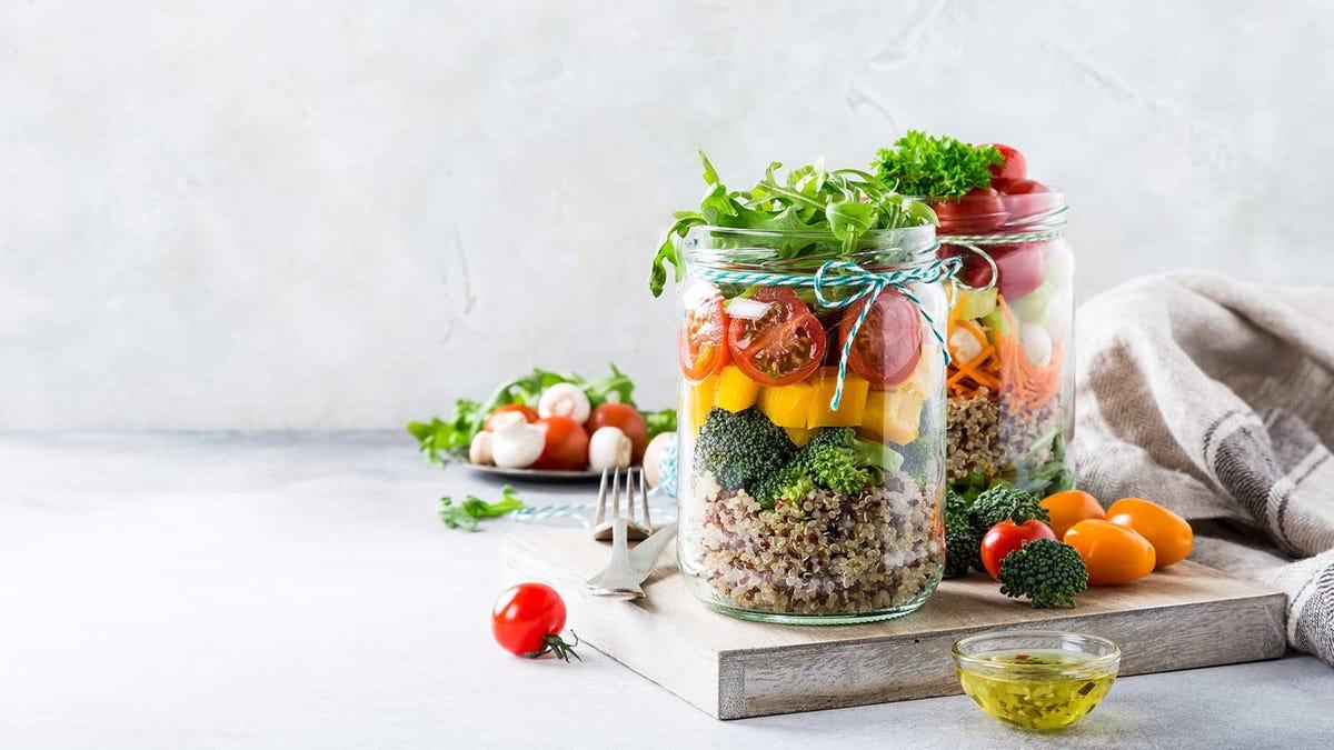 delicious mason jar salads on a cutting board in a sunny kitchen