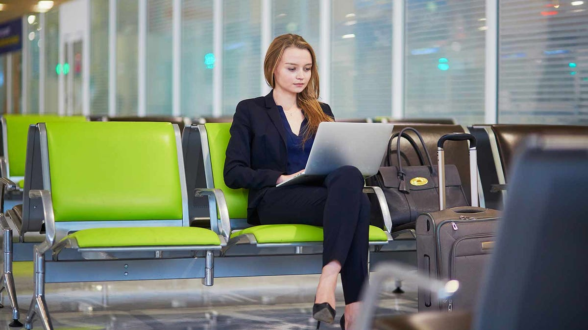 woman working in airport waiting area