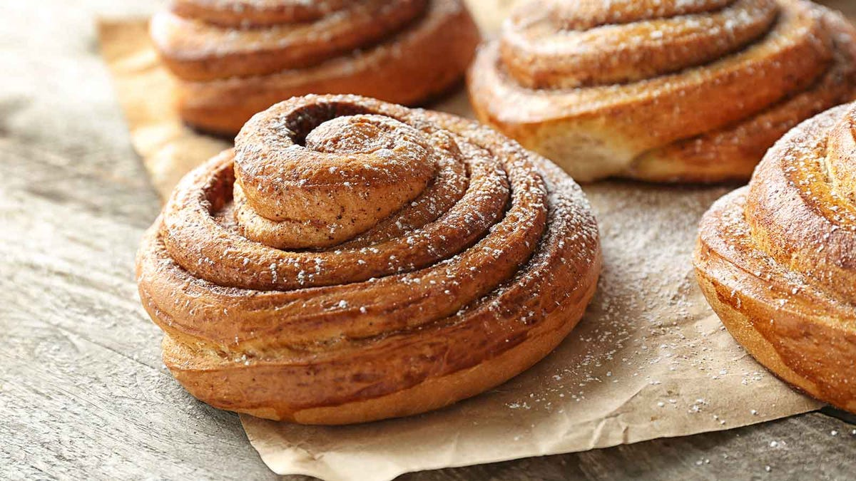 large cinnamon rolls dusted with cinnamon and powdered sugar