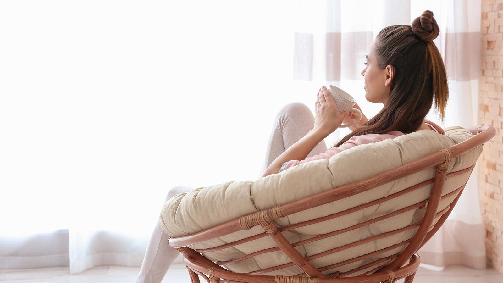 woman drinking coffee at home before going to work