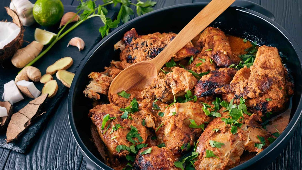 Kenyan chargrilled chicken in a stout cast iron Dutch oven dish.