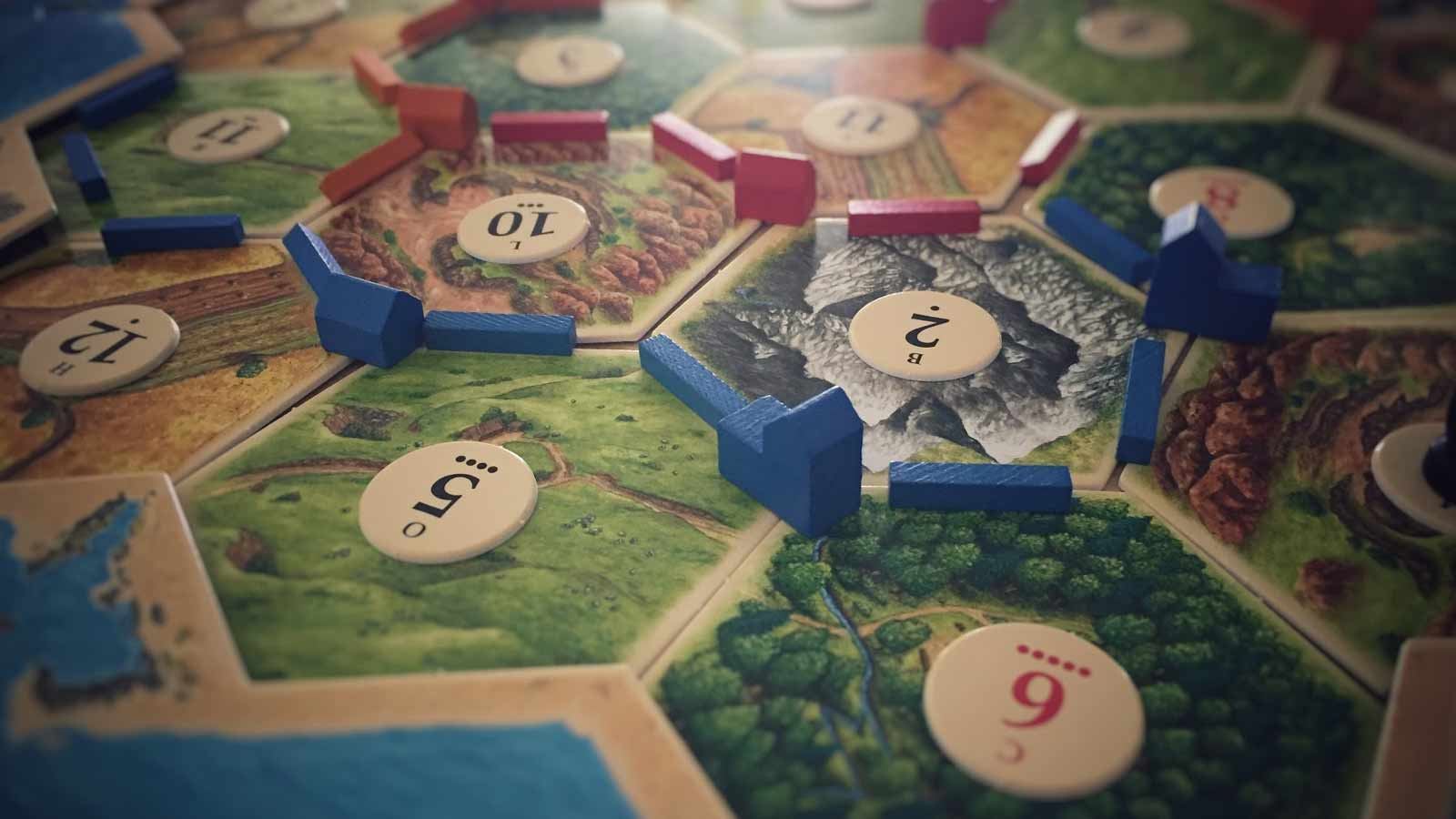The Settlers of Catan board game with multiple settlements.