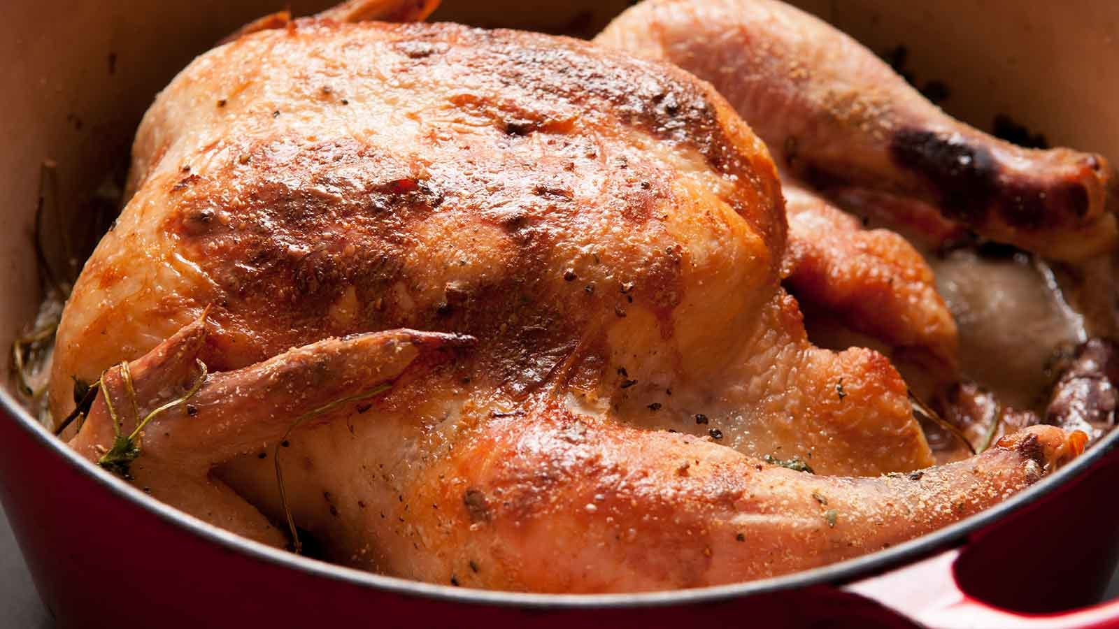 whole chicken, roasted with coconut and lemongrass, in a Dutch oven