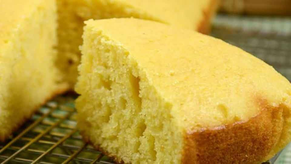 close up of a slice of cornbread on a cooling rack