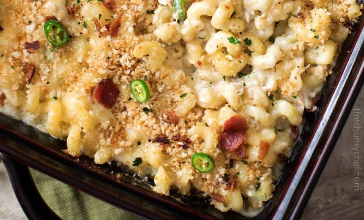 A casserole dish filled with Jalapeno and bacon mac and cheese.