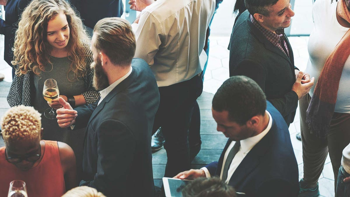 a diverse group of business people socializing at a networking event