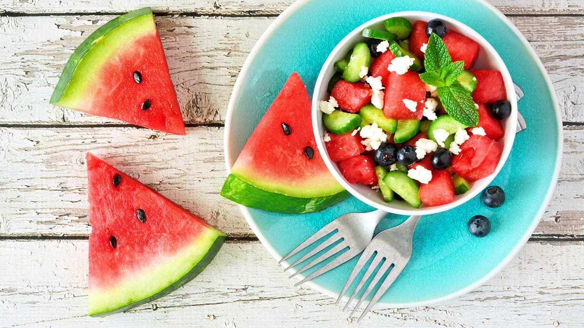 A watermelon salad with cucumber, blueberries and feta cheese.