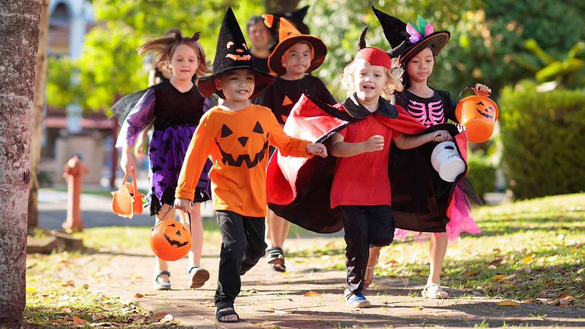 group of children out trick or treating