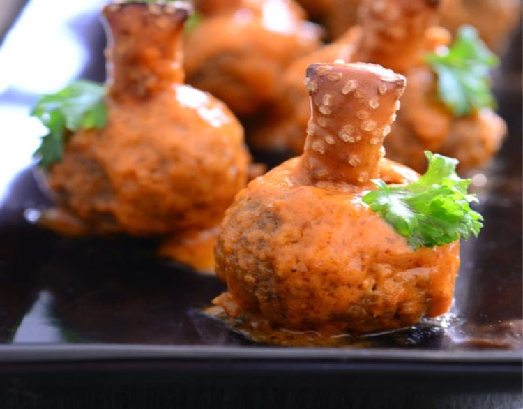 Little meatballs that resemble pumpkins