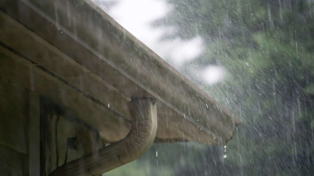 house gutters in the pouring rain