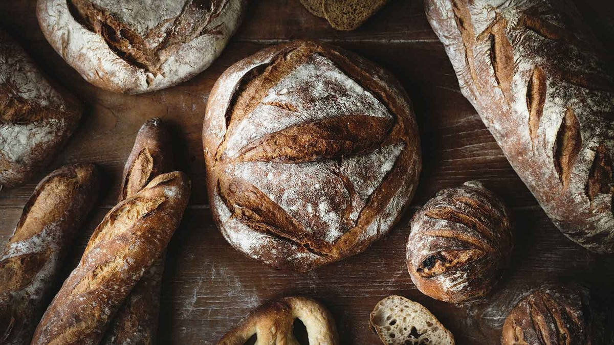 A table full of artisan breads.
