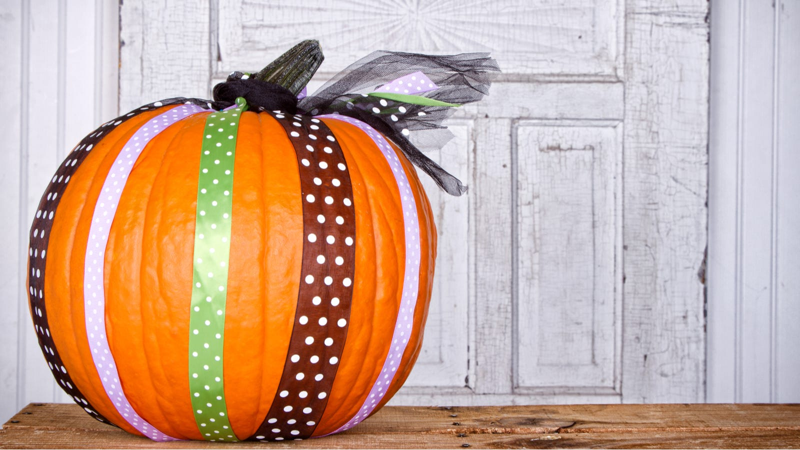 Pumpkin wrapped up with ribbons