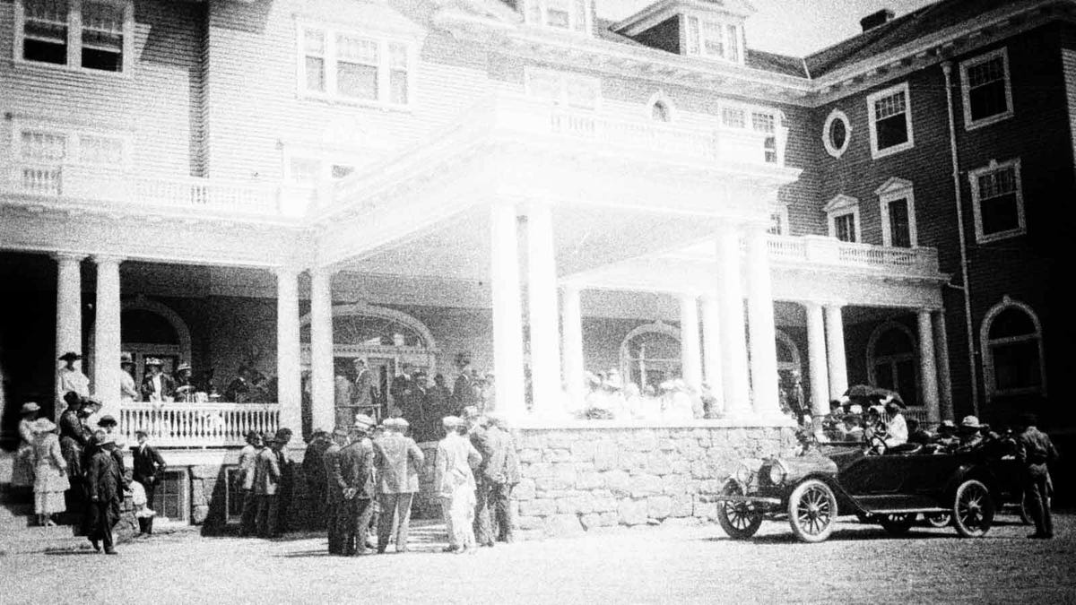 Guests arriving at one of the porches at The Stanley Hotel in Estes Park, Colorado