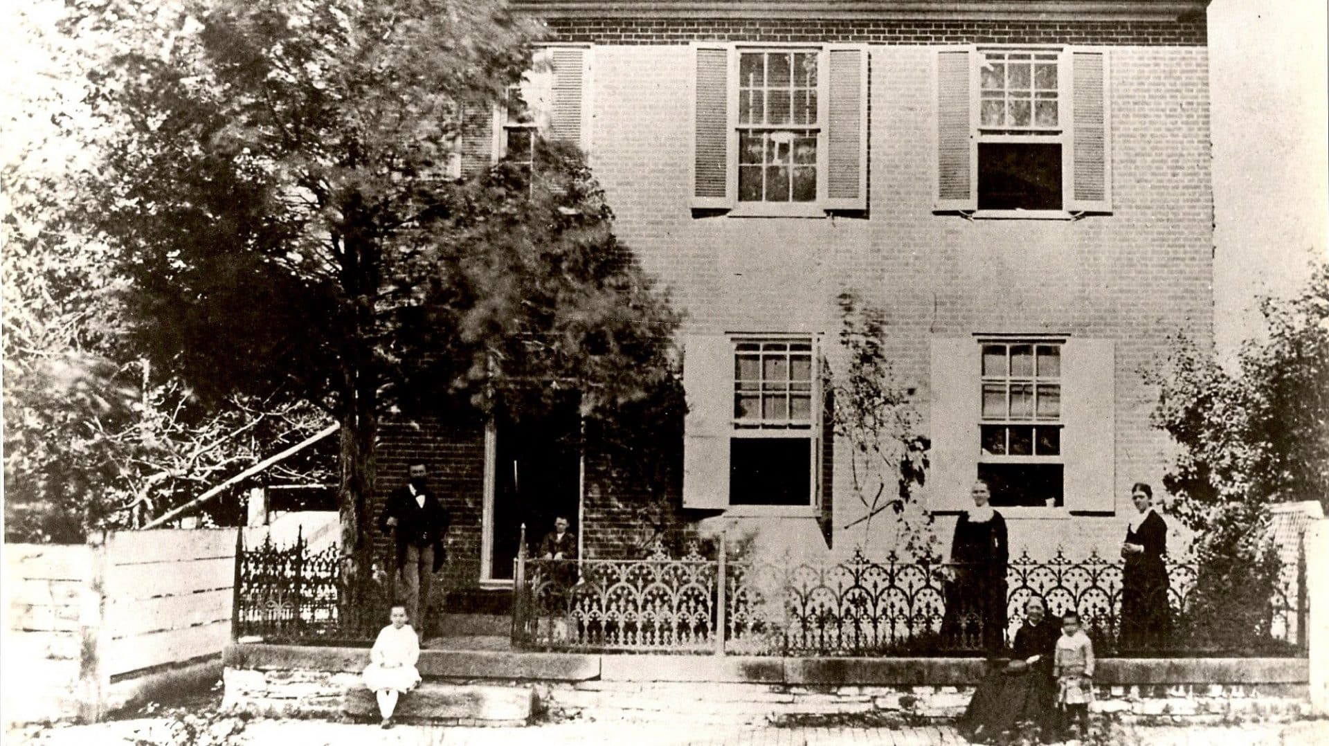 Vintage photograph of the Farnsworth House with the original family outside