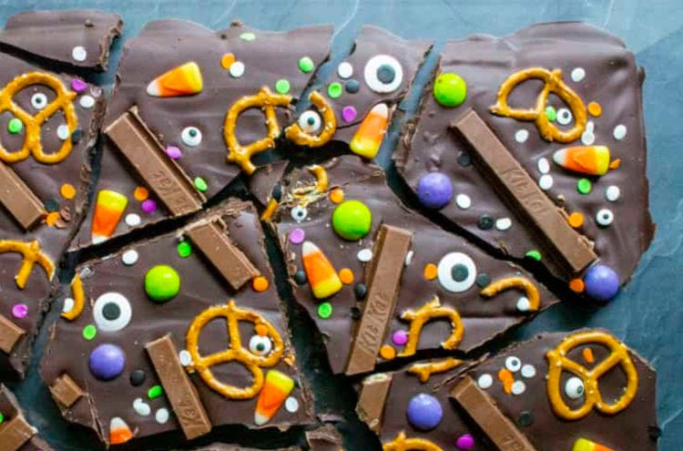 Candy Bark made with chocolate, kit Kats , candy corn, pretzels and M&M's.