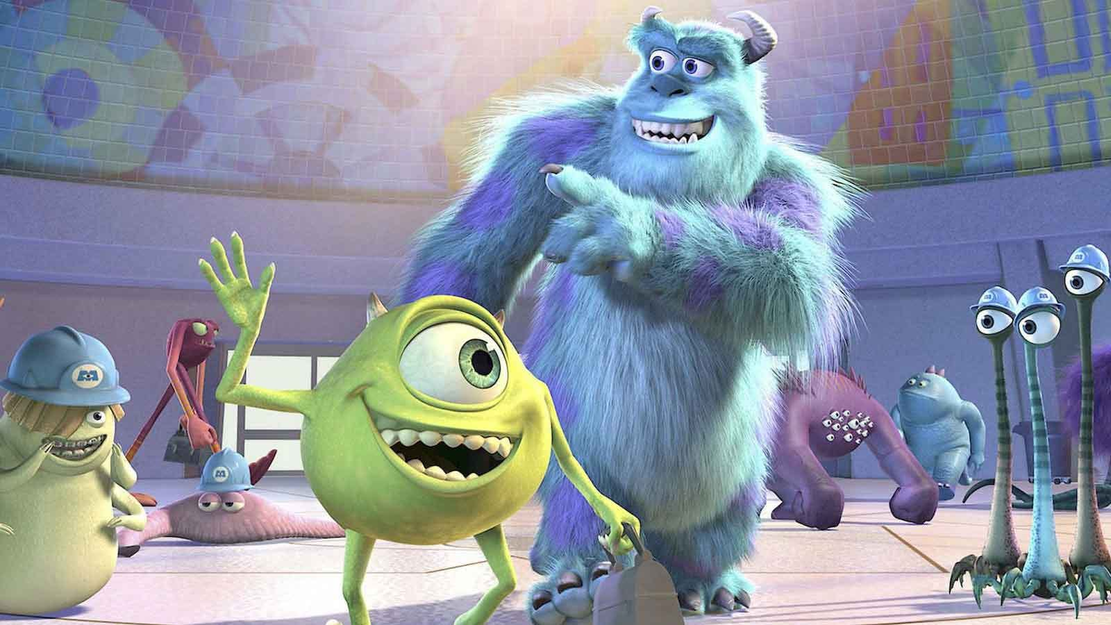 The main characters from Monsters, Inc. waving at their coworkers.