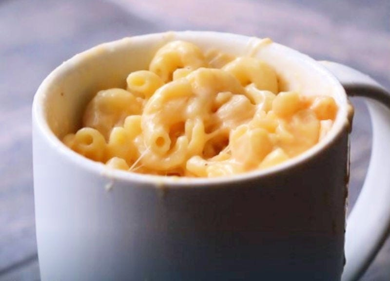A coffee mug filled with five-minute mac and cheese.
