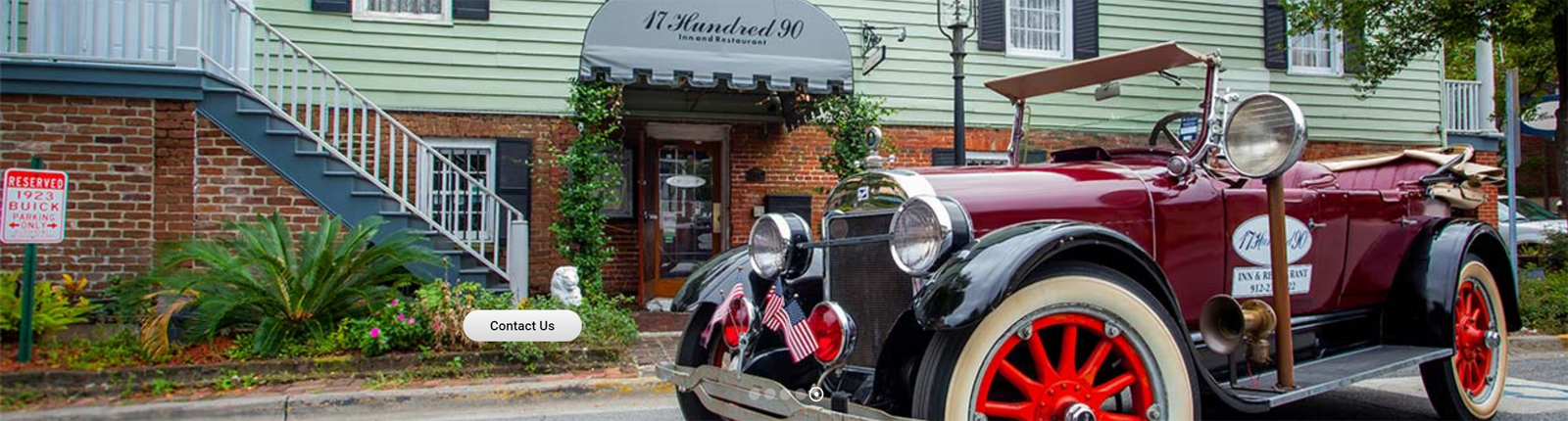 A burgundy 1923 Buick parked in front of the 17 Hundred 90 Inn and Restaurant.