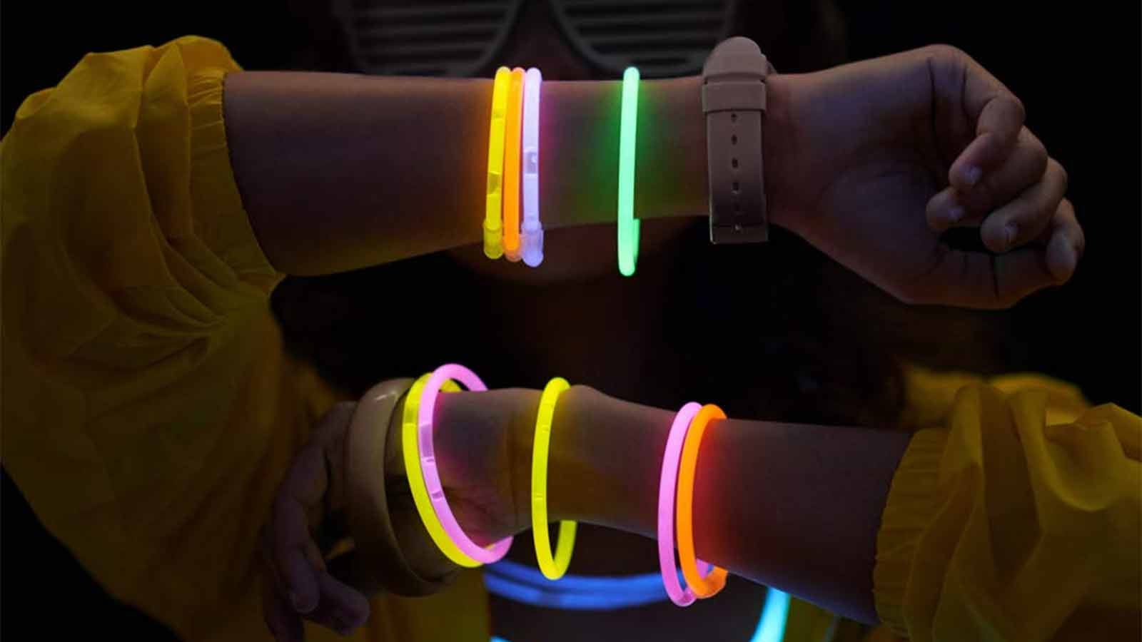 a teenager with glow stick bracelets