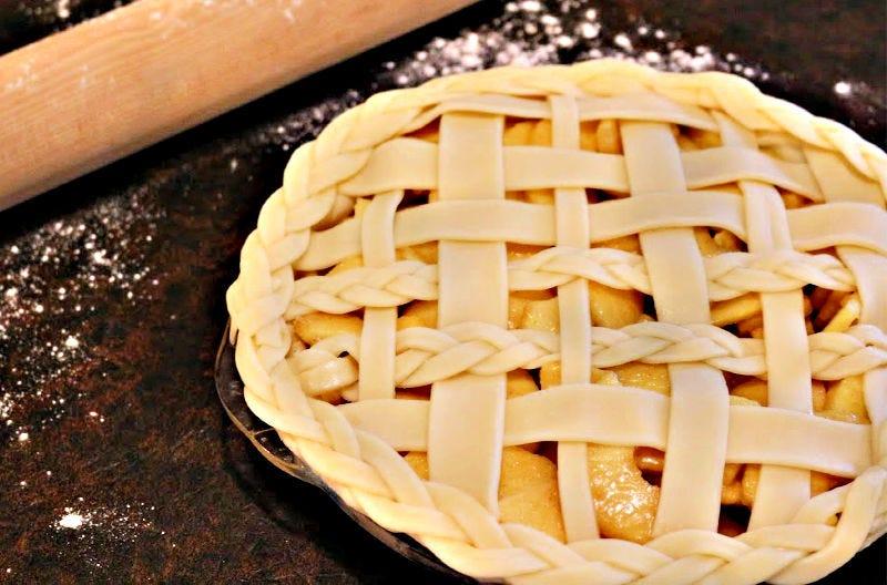 A beautiful apple pie with a braided lattice piecrust.