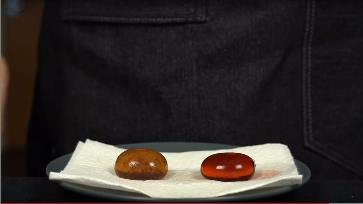 two amber-colored cocktail pods on a plate