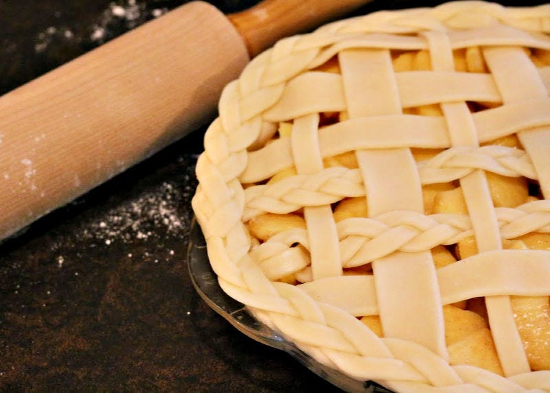 A long braided edge has been added to the border of a pie.