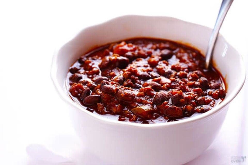 A bowl of chili with a spoon