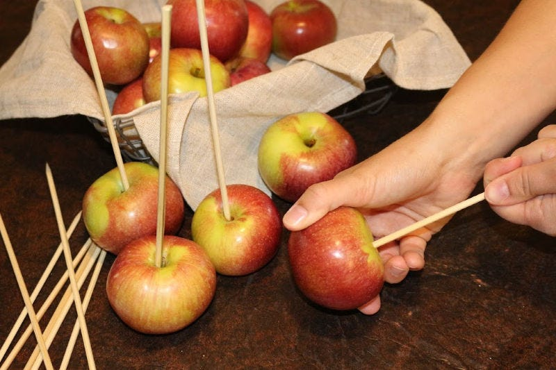 Placing a skewer in an apple