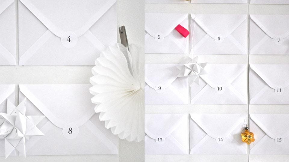 a clever advent calendar made from white envelopes