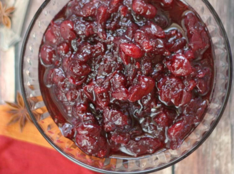A clear glass bowl full of homemade cranberry sauce