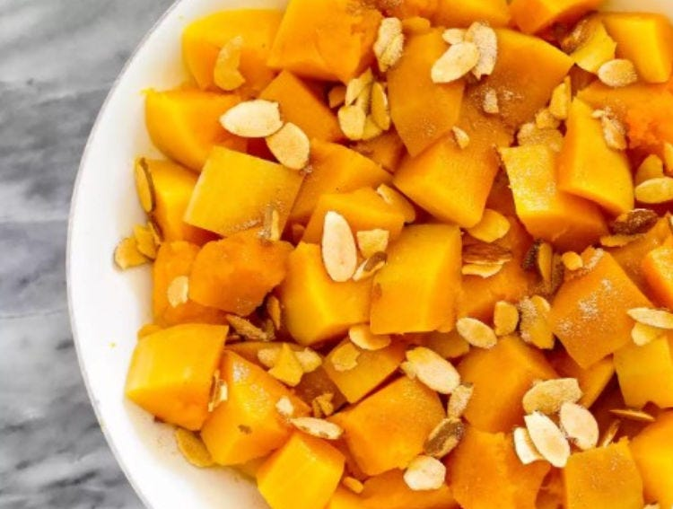 A plate of Butternut Squash, topped with sliced almonds.