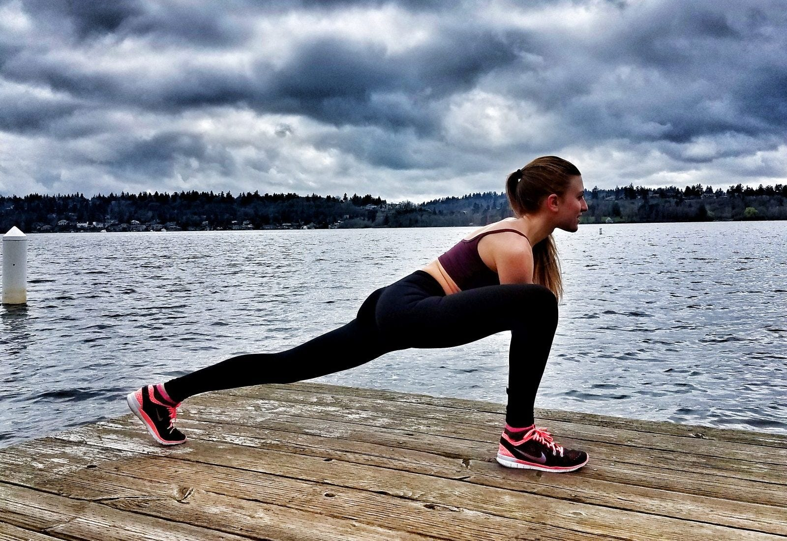 woman stretching in runner's lunge