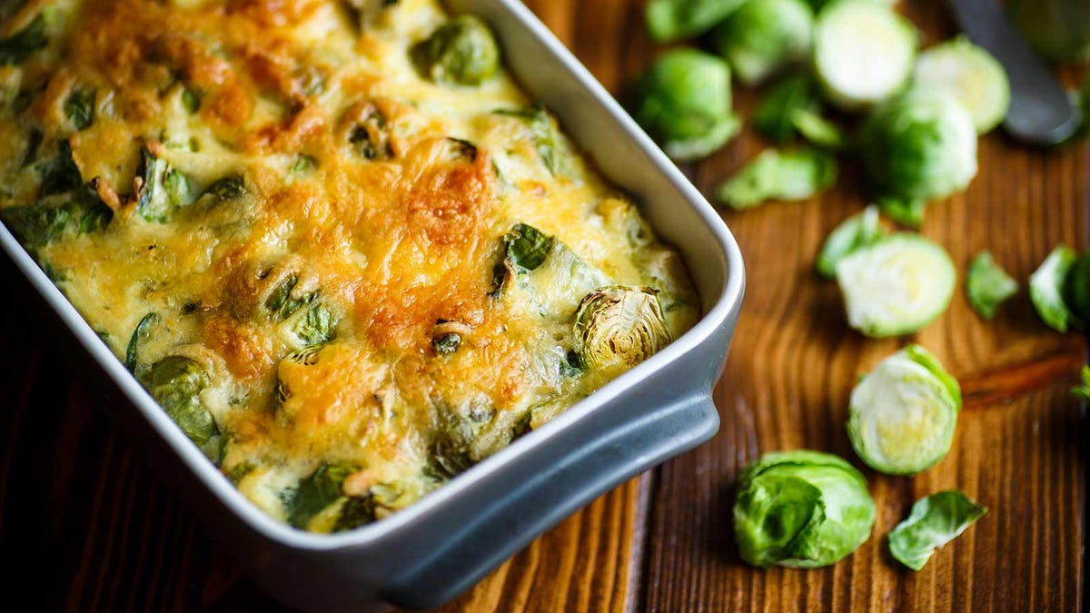 a delicious casserole dish filled with cheesy Brussels sprouts
