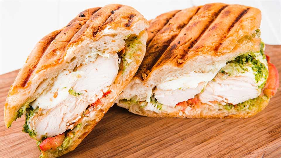 a delicious panini pressed pesto chicken sandwich