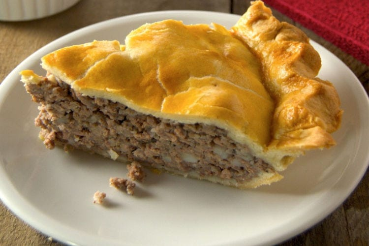 A slice of freshly made French-Canadian meat pie.
