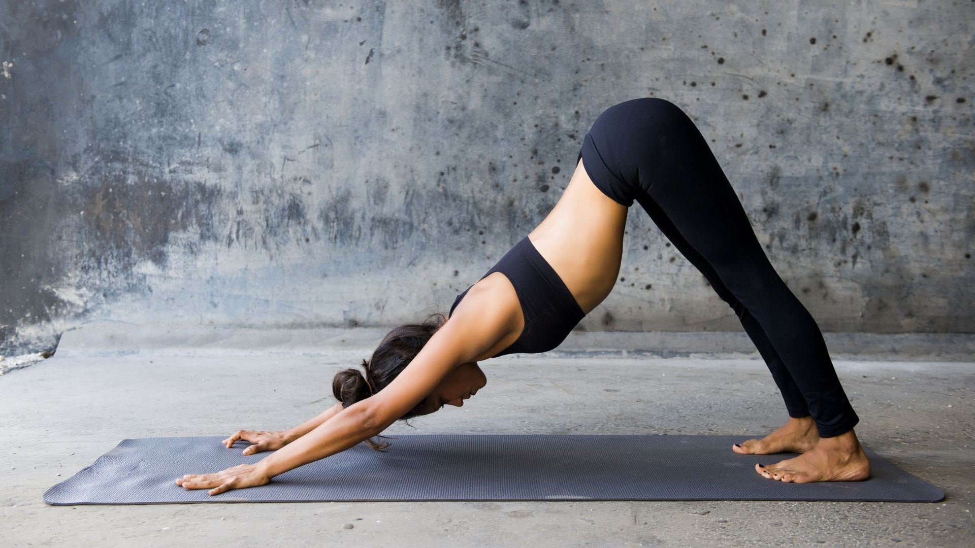 A woman in the downward dog yoga pose.